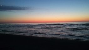 Mar do por do sol Imagens de Stock