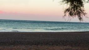 Mar en la salida del sol almacen de video