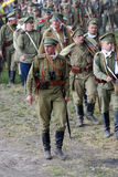 Marсhing Russian soldiers-reenactors. Royalty Free Stock Image