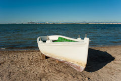 Mar Menor. A traditional fishing boat resting on a Mar Menor Beach, Costa Calida, Murcia, Spain Stock Photo