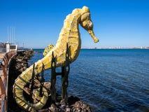 Mar Menor Lagoon Spain. Sea horse sculpture on the shore of the Mar Menor lagoon, with La Manga holiday resort on the horizon. Los Nietos, Murcia, Spain Stock Photography
