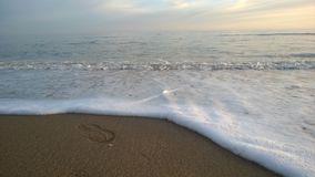 Mar no por do sol Imagem de Stock