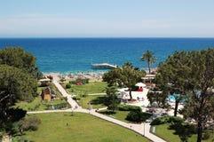 Mar, playa y jardín Imagen de archivo libre de regalías