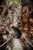 Young asian male with casual cloth in forest cave travel in nature concept. Thailand stock image