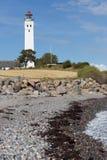 Mar y faro de piedra Fotografía de archivo libre de regalías