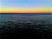Mar y puesta del sol foto de archivo