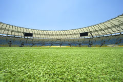 Maracana Football Stadium Pitch Level View. Pitch-level view of Maracana football soccer stadium under bright blue sky Royalty Free Stock Photo