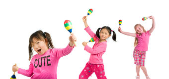 Maracas. Three young girls playing maracas. Diversity in friends Stock Photography