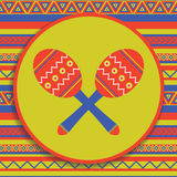 Maracas on patterned background. Traditional mexican musical instrument on patterned background Royalty Free Stock Images