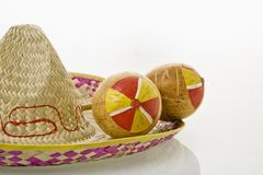 Maracas and sombrero. Pair of handmade Mexican maracas percussion musical instruments on sombrero straw hat stock photos