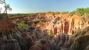 Marafa Depression Hell`s Kitchen canyon with red cliffs stock image