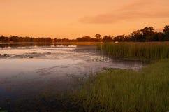 Marais de coucher du soleil Photographie stock libre de droits