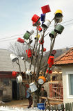 Maramures, Romania. BARSANA, ROMANIA - CIRCA MAY: A traditional Maramures home keep a tree  decorated with pots as a sign for passers-by that the household has a Royalty Free Stock Photos