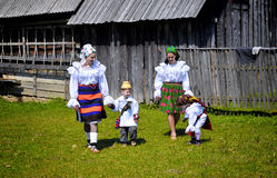 Maramures traditional people. Two young woman and two young childrens wearing specific handmade clothes in Maramures, Romania Stock Image