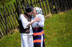 Maramures traditional people. Two young traditional people in specific handmade clothes from Maramures kissing Stock Photo