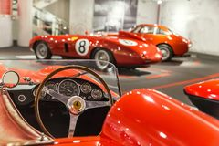 Maranello, Italy – July 26, 2017: Exhibition in the famous Ferrari museum Enzo Ferrari of sport cars, race cars and f1. Close up of dashboard and steering Royalty Free Stock Image
