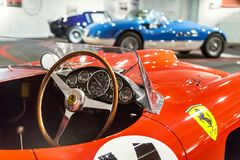 Maranello, Italy – July 26, 2017: Exhibition in the famous Ferrari museum Enzo Ferrari of sport cars, race cars and f1. Close up of dashboard and steering Stock Image