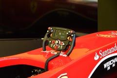 MARANELLO ITALY - MAY 17, 2016: Public race car Simulator on Ferrari F1 with large audience . MARANELLO ITALY - MAY 17, 2016: Public race car Simulator on stock photography
