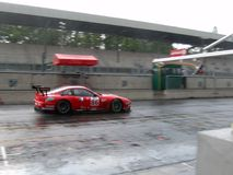 Maranello in Monza. Prodrive's Ferrari 550 Maranello GT1 passing through a wet Monza's pitlane during the 2004 1000km ALMS race (that same car won the event Royalty Free Stock Photos