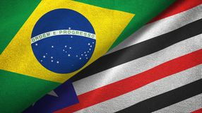 Maranhao state and Brazil flags textile cloth, fabric texture. Maranhao state and Brazil folded flags together royalty free illustration