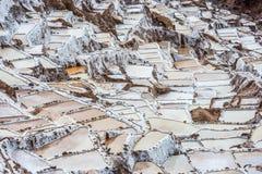 Maras salt mines peruvian Andes Cuzco Peru. Maras salt mines in the peruvian Andes at Cuzco Peru stock photos
