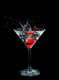 Maraschino cherry dropped in cocktail glass Stock Photo