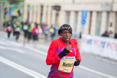 Marathon. 10/28/2012 Ljubljana, Slovenia. Jane Rotich from Kenia runs to a fourth place in the Ljubljana Marathon. With a temperature of 2 degrees Celsius and Royalty Free Stock Photo