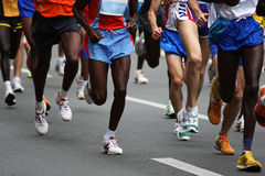 Marathon. Runners on the street Royalty Free Stock Images