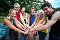 Marathon athlete making motivation gesture. In park Royalty Free Stock Photos