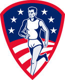 Marathon athlete sports runner. Illustration of an American Marathon athlete sports runner with stars and stripes and set in shield done in retro style Royalty Free Stock Image
