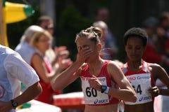 Marathon athletes. One of the top 3 female favorites (Kiraz Ümmü - Turkey) on her way to the last 8 kilometres on the international Düsseldorf city marathon stock image