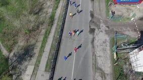 Marathon athletes group across the bridge in the spring. HD stock footage