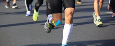 Marathon athletes run Stock Photo