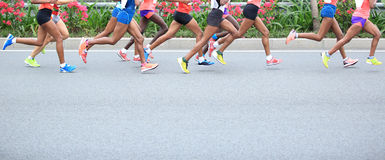 Marathon athletes running. Marathon athletes runner running on street royalty free stock photography