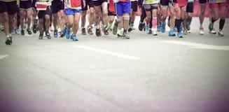 Marathon athletes running. On street Royalty Free Stock Photography