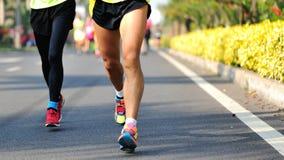 Marathon athletes running. On street Stock Image