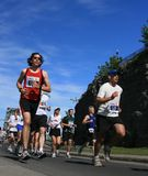 Marathon Beside Cliff Stock Images