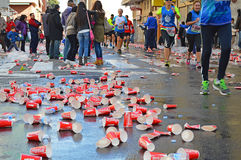 Marathon Drinks Station Littered With Coke Cans Stock Photography