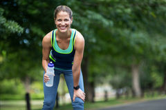 Marathon female athlete running drinking water Stock Photos