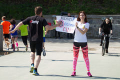 Marathon in Kyiv, Ukraine. Pretty girl standing with a banner Royalty Free Stock Image