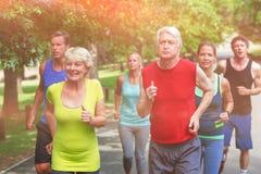 Marathon male and female athletes running royalty free stock photos