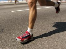 Marathon man. Runner legs in motion at the 2006 Rio de Janeiro International Half Marathon Royalty Free Stock Image