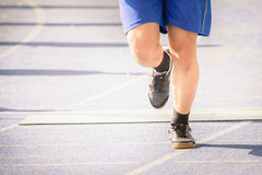 Marathon of man's feet jogging outdoor by the road Stock Photography