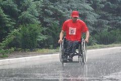 Marathon men with paraplegia. Ukraine, Crimea, Saki, 15-JUN-2013: International Marathon Scythian coast, people with limited mobility, spinal cord injury and Stock Photo
