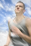 Marathon Motions. Emotion Captured As An Athletic Man Moves In Marathon Motions Royalty Free Stock Photography