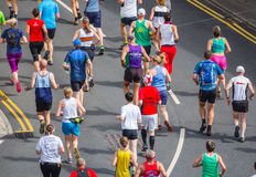 Marathon people running. On the road, away shot in the annual Race the train event, Tywyn, Wales. August 15th 2015 royalty free stock photography