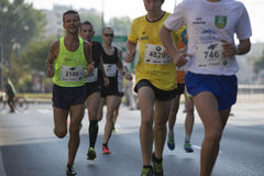 1/2 Marathon Prague 2016 – Kenyans fastest in Warsaw. Warsaw, Poland - Kenyan runners as soon as they defeated in Warsaw of 21 km 97 m Route 3. BMW of the Stock Photography