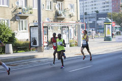 1/2 Marathon Prague 2016 – Kenyans fastest in Warsaw. Warsaw, Poland - Kenyan runners as soon as they defeated in Warsaw of 21 km 97 m Route 3. BMW of the Stock Image