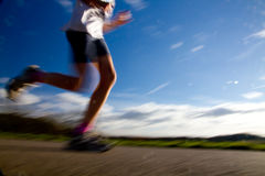 Marathon race. Runner in a marathon race in blurred motion Stock Photography