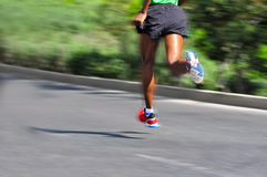 Marathon Racer. Running with motion blur Royalty Free Stock Images